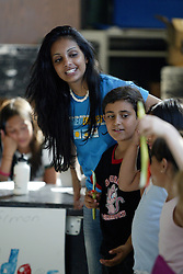 Counselor, left, at YMCA day camp, Redwood City, Calif., Friday, July 1, 2005. (Photo by D. Ross Cameron)