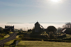 © Licensed to London News Pictures. 27/05/2021.  Llanddewi'r Cwm, Powys, Wales, UK. St David's church is surrounded by mist in the tiny village of Llanddewi'r Cwm, in Powys after a very cold night with temperatures dropping to 1 deg C in parts of Powys. Photo credit: Graham M. Lawrence/LNP
