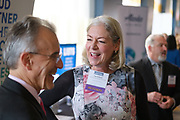 Kate Roberts of Monterey Bay Economic Partnership talks with others during the Silicon Valley Business Journal's Women of Influence event at the Fairmont San Jose in San Jose, California, on May 16, 2019. (Stan Olszewski for Silicon Valley Business Journal)