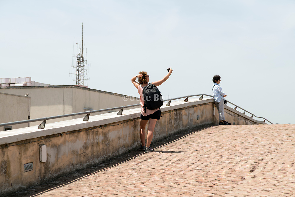 tourist making a selfie at Castel Sant'Elmo  in Naples Italy