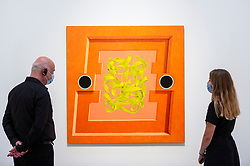 """© Licensed to London News Pictures. 07/09/2021. LONDON, UK. Staff members view """"Untitled"""", 2021, by Daniel Sinsel. Preview of 'Mixing It Up: Painting Today', a group new exhibition at the Hayward Gallery which highlights the UK's emergence as a vital international centre of contemporary painting with works by 31 artists on display.  The show runs 9 September to 12 December.  Photo credit: Stephen Chung/LNP"""
