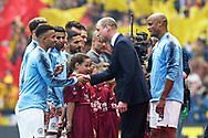 Vincent Kompany (4) of Manchester City introduces HRH Prince William to the Manchester City players ahead of the The FA Cup Final match between Manchester City and Watford at Wembley Stadium, London, England on 18 May 2019.