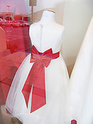 flower girl's dress displayed in a window