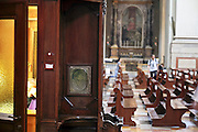 priest sitting and waiting in his confessional Italy