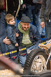 A little boy has a great time with his dad as they check out the great custom bikes at the Custom and Tuning Show, the custom bike show portion of the big Motor Spring bike show in Moscow, Russia. Saturday April 22, 2017. Photography ©2017 Michael Lichter.