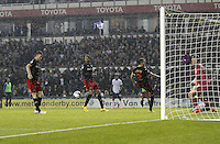 Reading's Alex Pearce puts the ball past Mikkel Andersen for a own goal<br /> <br /> Photographer Mick Walker/CameraSport<br /> <br /> Football - Capital One Cup Third Round - Derby County v Reading - Tuesday 23rd September 2014 - iPro Stadium - Derby<br />  <br /> © CameraSport - 43 Linden Ave. Countesthorpe. Leicester. England. LE8 5PG - Tel: +44 (0) 116 277 4147 - admin@camerasport.com - www.camerasport.com