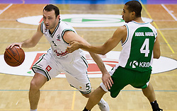 Goran Jeretin of Olimpija vs Sean Mustafa Abdul-Ham of Krka during basketball match between KK Union Olimpija Ljubljana and KK Krka Novo mesto of finals of 11th Slovenian Spar Cup 2012, on February 19, 2012 in Sports hall Brezice,  Brezice, Slovenia. (Photo By Vid Ponikvar / Sportida.com)