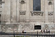 Friends enjoy a lunchtime chat in summer sunshine beneath Wren architecture of St Paul's Cathedral in the City of London, the capital's financial district, on 23rd June 2021, in London, England.
