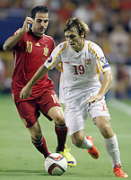 Spain's Cesc Fabregas (l) and Fyrom's Besart Abdurahimi during 15th UEFA European Championship Qualifying Round match. September 8,2014.(ALTERPHOTOS/Acero)