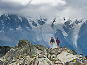 "Day hikers walk the High Route (Chamonix-Zermatt Haute Route) across from vast glaciers of the Mont Blanc Massif, Chamonix, France, Europe, in the Reserve Naturelle Aiguilles Rouges. Published in Ryder-Walker Alpine Adventures ""Inn to Inn Alpine Hiking Adventures"" Catalog 2006."
