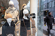 Mannequins wearing face masks in a shop window on Oxford Street which is mainly empty of shoppers as the national coronavirus lockdown three continues on 28th January 2021 in London, United Kingdom. Following the surge in cases over the Winter including a new UK variant of Covid-19, this nationwide lockdown advises all citizens to follow the message to stay at home, protect the NHS and save lives.