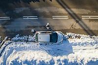 Drone selfie on the side of snowy road.