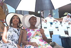 Pretoria 26-12-18. The 1st of three 5 day cricket Tests, South Africa vs Pakistan at SuperSport Park, Centurion. Day 1. Daughter and mom, Mmathabo and Mpume Tladi from Roodepoort, share an umbrella  in full sun during the morning session as temperatures soared to around 35deg Celcius. Picture: Karen Sandison/African News Agency(ANA)