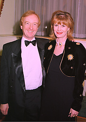 TV news reader NICHOLAS WITCHELL and MISS CAROLYN STEPHENSON, at a ball in London on 29th January 1998.MEY 35