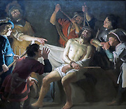 Christ Crowned with Thorns by Gerard van Honthorst (1592-1656)  oil on canvas, c 1622.  Before Christ's trial, Roman soldiers placed a plaited crown of thorns on his head, dressed him in a cloak and mocked him.  After all, was he not the 'King of the Jews'?  The scene is dramatically illuminated by a torch, held by the boy at the left.  Honthorst probably made this painting for a clandestine Catholic church (schullkerk) in Amsterdam.