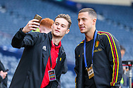 Eden Hazard (#10) of Belgium stops for a selfie with a supporter ahead of the International Friendly match between Scotland and Belgium at Hampden Park, Glasgow, United Kingdom on 7 September 2018.