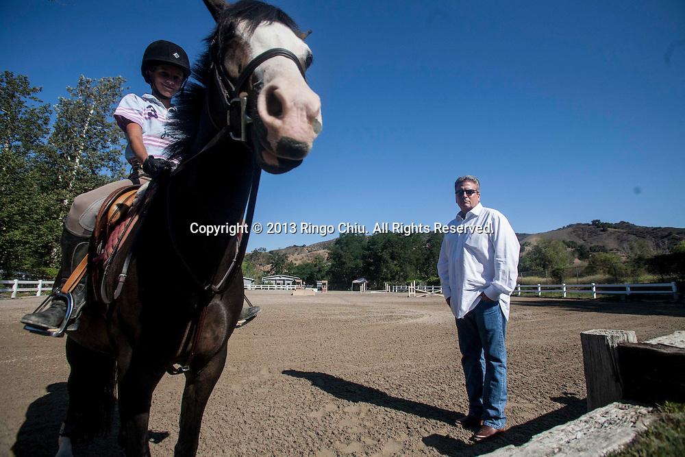 Brian Boudreau, owner of Malibu Valley Farms, a thoroughbred horse breeding operation in the Santa Monica Mountains. (Photo by Ringo Chiu/PHOTOFORMULA.com)