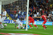 Steve Morison of Wales (c) scores the opening goal. Euro 2012 Qualifying match, Wales v Montenegro at the Cardiff City Stadium in Cardiff  on Friday 2nd Sept 2011. Pic By  Andrew Orchard, Andrew Orchard sports photography,