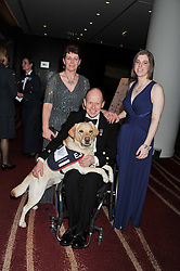 ALLEN PARTON with his wife SANDRA and daughter ZOE and his dog EJ at the Soldiering On Awards 2013 held at the Park Plaza Hotel, Westminster Bridge, London SE1 on 23rd March 2013.