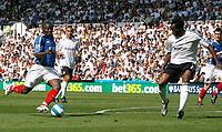 Photo: Steve Bond. <br />Derby County v Portsmouth. Barclays Premiership. 11/08/2007. Sulley Muntari (L) prepares to shoot as Claude Davis (R) closes