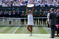 Angelique Kerber with the trophy on day twelve of the Wimbledon Championships at the All England Lawn Tennis and Croquet Club, Wimbledon. PRESS ASSOCIATION Photo. Picture date: Saturday July 14, 2018. See PA story TENNIS Wimbledon. Photo credit should read: Jonathan Brady/PA Wire. RESTRICTIONS: Editorial use only. No commercial use without prior written consent of the AELTC. Still image use only - no moving images to emulate broadcast. No superimposing or removal of sponsor/ad logos. Call +44 (0)1158 447447 for further information.