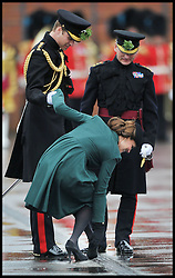 The Duchess of Cambridge Is helped by Prince William as she gets her heel stuck in a drain on the parsed ring at the  Irish Guards' St Patrick's Day Parade and presentation of shamrock by HRH The Duchess of Cambridge, Sunday March 17, 2013. Photo By Andrew Parsons / i-Images
