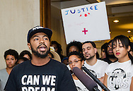 Phillip Agnew, director of Dream Defenders, speaks during a press conference July 23, 2013 at the Florida state capitol in Tallahassee. Behind him are some of the other members of the youth-led activist group, which commandeered Florida Gov. Rick Scott's office July 16, 2013 and have refused to leave until he calls a special session to address their concerns about racial profiling, the school-to-prison pipeline, and Florida's stand-your-ground law. (Photo by Carmen K. Sisson/Cloudybright)