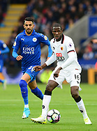 Abdoulaye Doucoure of Watford ®  goes past  Riyad Mahrez of Leicester. Premier league match, Leicester City v Watford at the King Power Stadium in Leicester, Leicestershire on Saturday 6th May 2017.<br /> pic by Bradley Collyer, Andrew Orchard sports photography.