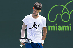 March 21, 2018 - Miami, FL, United States - Miami, FL - March, 21: Novak Djokovic (SRB) and Alexander Zverev (GER) practice together at the 2017 Miami Open held at the Tennis Center at Crandon Park.   Credit: Andrew Patron/Zuma Wire (Credit Image: © Andrew Patron via ZUMA Wire)