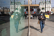 Face masks windown reflection on Piccadilly as the national coronavirus lockdown three continues on 5th March 2021 in London, United Kingdom. With the roadmap for coming out of the lockdown has been laid out, this nationwide lockdown continues to advise all citizens to follow the message to stay at home, protect the NHS and save lives, and the streets of the capital are quiet and empty of normal numbers of people.