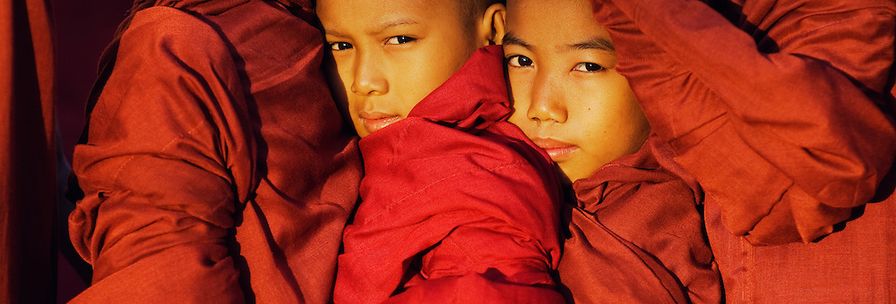 Young Novice Monks being crushed in procession line at Ananda Temple Festival