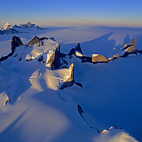 The Troll's Castle and Filchner Mountains cast long shadows at midnight, Queen Maud Land, Antarctica.  (Mount Gessnertind & Muhlig-Hofmann Mountains bkg.)