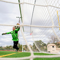 082614  Adron Gardner<br /> <br /> Gallup Bengal goalkeeper Robert Morrissett dives for a block while warming up for a match against the Rehobth Lynx at Public School Stadium in Gallup Tuesday.
