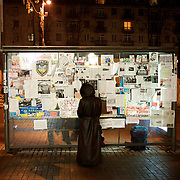 December 18, 2013 - Kiev, Ukraine: A local woman looks at Pro-EU panflets stick to the back of a bus stop in Independence Square, known locally as Maidan.<br /> On the night of 21 November 2013, a wave of demonstrations and civil unrest began in Ukraine, when spontaneous protests erupted in the capital of Kiev as a response to the government's suspension of the preparations for signing an association and free trade agreement with the European Union. Anti-government protesters occupied Independence Square, also known as Maidan, demanding the resignation of President Viktor Yanukovych and accusing him of refusing the planned trade and political pact with the EU in favor of closer ties with Russia.<br /> After a days of demonstrations, an increasing number of people joined the protests. As a responses to a police crackdown on November 30, half a million people took the square. The protests are ongoing despite a heavy police presence in the city, regular sub-zero temperatures, and snow. (Paulo Nunes dos Santos/Polaris)
