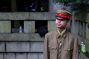 A young Japanese man in Imperial Army uniform as Yasukuni shrine marks the 72nd anniversary of the end of the Pacific War. Yasukuni Shrine, Kudanshita, Tokyo Japan. Tuesday August 15th 2017. Nominally a event to honour Japan's war dead and call for continued peace, this annual gathering  at Tokyo's controversial Yasukuni  Shine also allows many Japanese nationalists to display their nostalgia for their Imperial past.Rightwing paramilitary groups, Imperial cos-players, politicians and many ordinary citizens come together at the shrine to march and wave flags. The day goes almost unreported in the mainstream Japanese media.