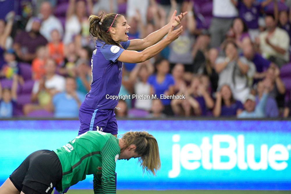 Orlando Pride's Alex Morgan celebrates after scoring a goal past Chicago Red Stars goalkeeper Alyssa Naeher, below, during the first half of an NWSL soccer match on Saturday, Aug. 5, 2017, in Orlando, Fla. (Photo by Phelan M. Ebenhack)