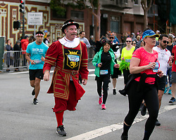 Dressed in his Beefeater's uniform, Tom Sweeney of San Francisco turns onto Divisidero at the 107th running of the Bay to Breakers, Sunday, May 20, 2018, in San Francisco. (Photo by D. Ross Cameron)