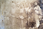 deteriorating family group portrait Japan ca 1930s
