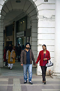 A man and his partner hold hands as they walk through Connaught Place, New Delhi<br /> Connaught Place was designed as the central business district of New Delhi by British architect Edwin Lutyens and over the last two years has been revamped by the New Delhi Municipal Council (NDMC) as part of its 'Return to heritage Project'.