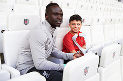 ISTANBUL, TURKEY - Tuesday, August 13, 2019: Liverpool's Sadio Mane with an young amputee footballer ahead of the UEFA Super Cup match between Liverpool FC and Chelsea FC at Besiktas Park. (Pic by Handout/UEFA)