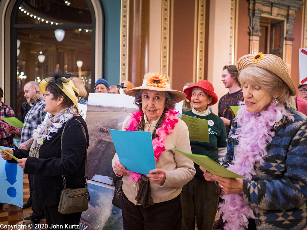 """23 JANUARY 2020 - DES MOINES, IOWA: The """"Raging Grannies"""" sing about the dangers of factory farms during a rally in the Iowa State Capitol against factory farms. About 75 people, including farmers, environmental activists, and supporters of family farms, came to a protest in the rotunda of the state capitol in Des Moines. They are trying to pressure Iowa lawmakers to pass a moratorium against new factory farm construction in Iowa.       PHOTO BY JACK KURTZ"""