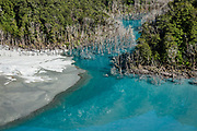 Forest killed by newly flooded lake. In this 2019 photo, Dart River forms a blue-green lake in Dredge Flat, dammed by the 2014 Jan 04 landslide, which required rough, rooty rerouting of three sections of the Rees-Dart Track, reopened in late 2017. Suspended glacial powder colors the lake turquoise. In 5 days, we tramped the strenuous Rees-Dart Track for 39 miles plus 12.5-mile side trip to spectacular Cascade Saddle, in Mount Aspiring National Park, Otago region, South Island of New Zealand.