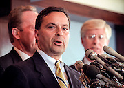 New York Attorney General Dennis Vacco with other state attorneys general discusses a $206 billion settlement with tobacco companies November 16, 1998 in Washington, DC.
