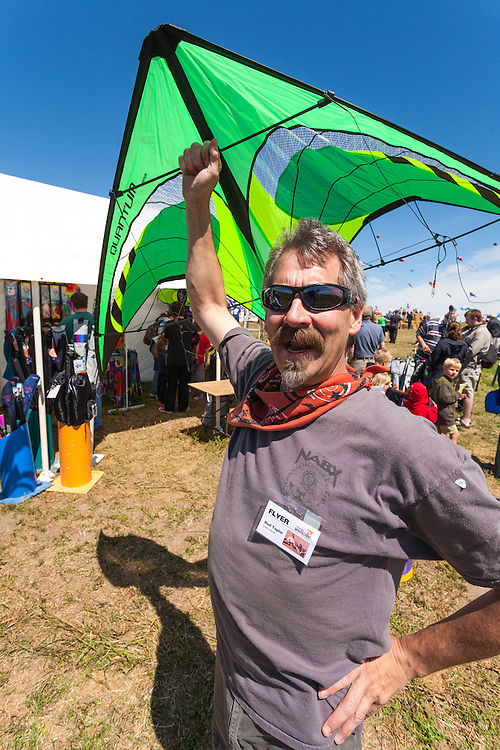 Bud Taylor, owner of The Kite Guys, Airdrie, Alberta. Windscape Kite Festival, Swift Current, Saskatchewan.
