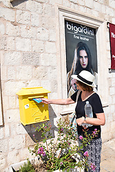 Tourist posting a postcard, Dubrovnik, Croatia, July 2018. MR