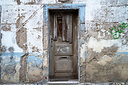 Muted colours of old house in need of renovation work in Evora, Portugal