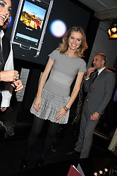 EVA HERZIGOVA at a party to celebrate the launch of the new Vertu Constellation phone - the luxury phonemakers first touchscreen handset, held at the Farmiloe Building, St.John Street, Clarkenwell, London on 24th November 2011.