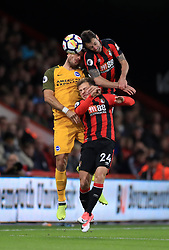Brighton & Hove Albion's Tomer Hemed (left) battles for the ball with AFC Bournemouth's Ryan Fraser and Adam Smith (right) during the Premier League match at the Vitality Stadium, Bournemouth.