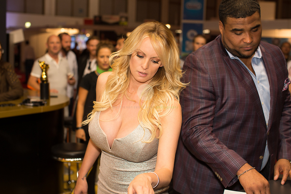 Berlin Expo Center, Berlin, GERMANY, 12.10.2018. Former adult actress Stephanie Clifford, known as Stormy Daniels signs an autograph for a visitor during the Venus Erotic Trade Fair in Berlin, Germany, 12 October 2018. Daniels, who allegedly had a sexual encounter in 2006 with US President Donald J. Trump, sued the president over a hush money agreement she signed before he ascended to the Oval Office. The Venus Berlin Fair is among the largest international erotic trade fairs, with more than 250 exhibitions from 40 countries and 30,000 visitors. <br /> <br /> Messegelaende unterm Funkturm, Berlin, DEUTSCHLAND, 12.10.2018. Stormy Daniels auf der VENUS 2018: Pornostar Sot Messegelaende unterm Funkturm, Berlin. 12.10.2018. Stormy Daniels auf der VENUS 2018: Stormy Daniels gibt Autogramme an der Erotic Lounge.  Daniels erlangte Bekanntheit durch eine angebliche Affaere mit US-Praesident Donald Trump. Anfang Oktober hat Daniels das Enthuellungsbuch Full Disclosure veroeffentlicht, in dem intimste Details ueber Donald Trump dargestellt werden.