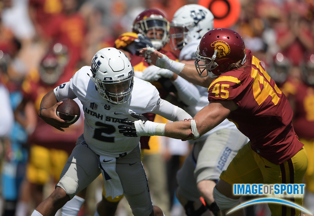 Sep 10, 2016; Los Angeles, CA, USA; Utah State Aggies quarterback Kent Myers (2) is sacked by USC Trojans defensive end Porter Gustin (45) during a NCAA football game at Los Angeles Memorial Coliseum. USC defeated Utah State 45-7.